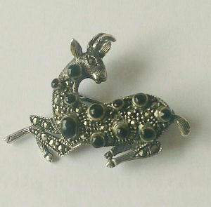 The deer is often used to describe a person who is a bounty. It is considered accepted to harrass and hunt a person referred to as a deer. This brooch is a family brooch, now stolen like most of my belongings except for a suitcase.